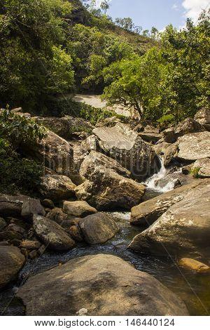 Water Falls Between Rocks In Sunny Day - Serra Da Canastra National Park - Minas Gerais, Brazil