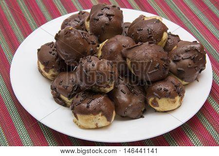 Chocolate cupcake on the plate. Carolina sweet typical Brazilian.