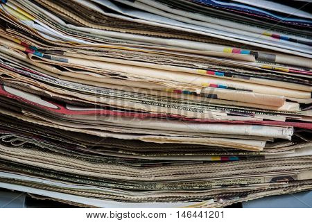 a stack of old newspapers and magazines, paper texture