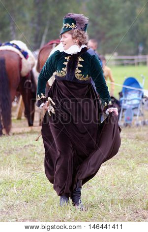 BORODINO MOSCOW REGION - SEPTEMBER 04 2016: Reenactor woman in elegant vintage dress at Borodino battle historical reenactment in Russia. Color photo.