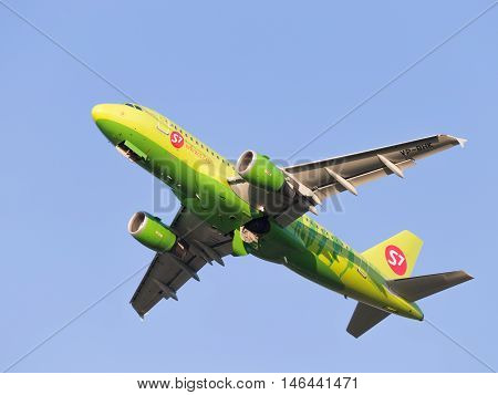 Moscow region - 31 July 2016: Green passenger aircraft Airbus A319-114 S7 Airlines flies to Domodedovo airport July 31 2016 Moscow Region Russia