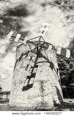 Old tower windmill in Holic Slovak republic. Architectural theme. Vertical composition. Cultural heritage. Black and white photo. Beautiful object. Travel destination.
