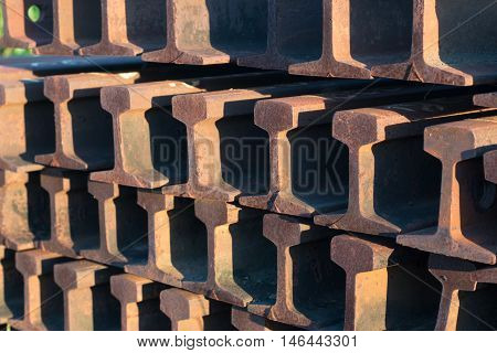 Steel rails track close up piled together beside the track