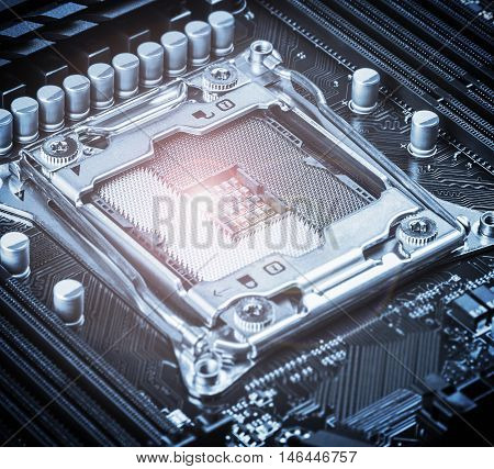 CPU socket on the motherboard. focus on CPU socket. toned image