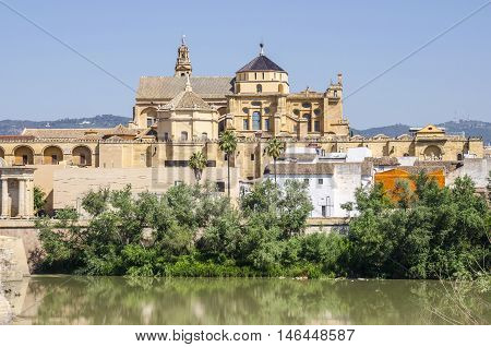 The View at the historic center of Cordoba across the Guadalquivir river and the Cathedral-Mosque of Cordoba in the background.