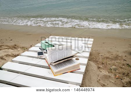 summer shore of the Black Sea with the trestle-beds phonebook sumochkoyna background waves