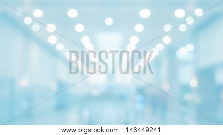 blue white bokeh blur of shopping mall background