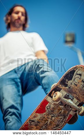 Skateboarder Riding In Skate Park