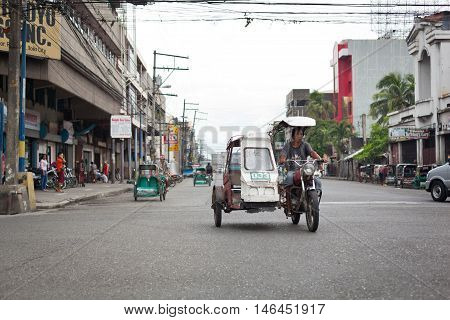 Riding A Tricycle Bicycle Taxi At Filipino Streets