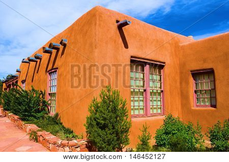 Adobe style building surrounded by a courtyard garden taken in Santa Fe, NM