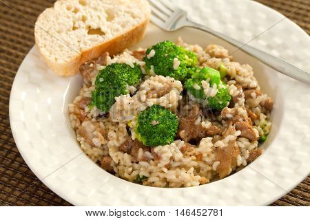 Slow cooked dish with chicken tights rice and broccoli.