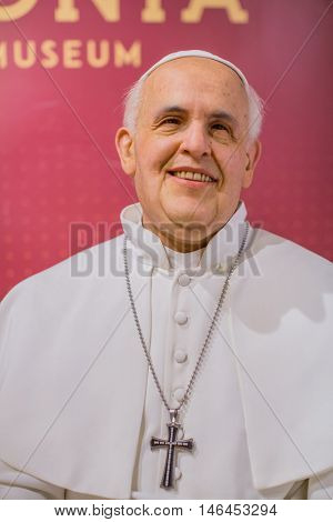 KRAKOW, POLAND - FEB 8, 2016: Pope Francis wax figure of Polonia Wax Museum at Main Market Square. The Wax Museum was opened in 2016, inspired by the organization in Krakow World Youth Day.