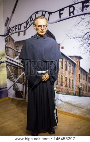 KRAKOW, POLAND - FEB 9, 2016: Maximilian Kolbe wax figure of Polonia Wax Museum at Main Market Square. The Wax Museum was opened in 2016, inspired by the organization in Krakow World Youth Day.