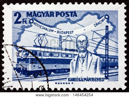 HUNGARY - CIRCA 1968: a stamp printed in Hungary shows Kando Statue Miskolc Kando Locomotive and Map of Hungary Kalman Kando Engineer and Inventor circa 1968