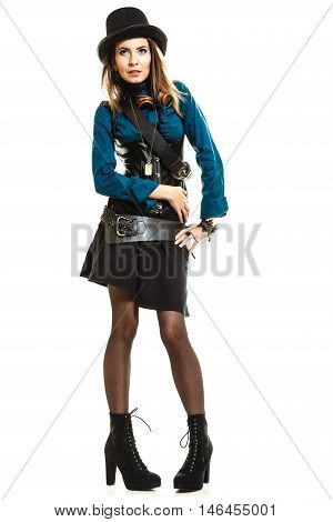 Young steampunk islolated girl on white wearing fancy hat. Fantasy old fashion with stylish topper and goggle.