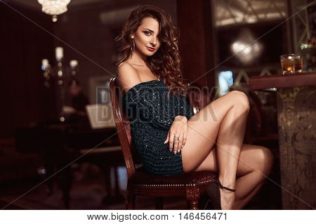 Beauty Young Brunette Woman Sitting At The Bar