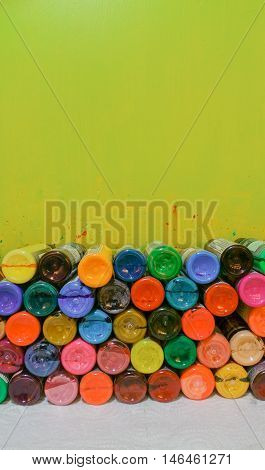 Bottles of colorful tattoo ink with wall background