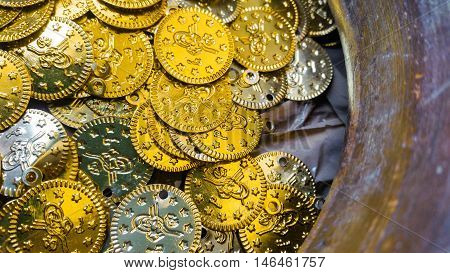 Close up of fake gold and silver coins