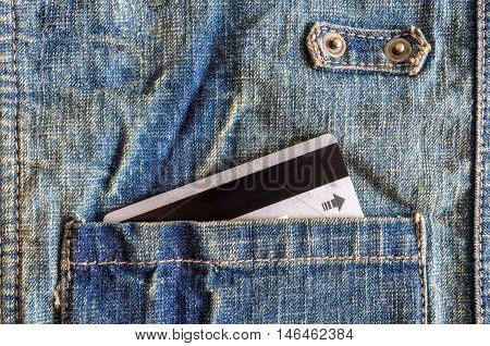 Close-up silver credit card in pocket of denim shirt.