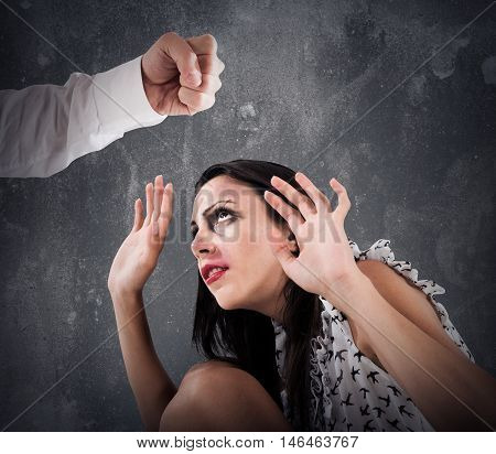 Scared woman with bruises from a man fist
