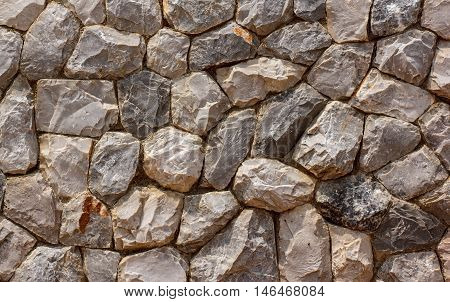 The Stones are arranged in rows at Beautiful spoon, stone walls texture background.