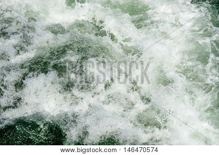 Foamy Sea Surface With Waves and Boat Trace