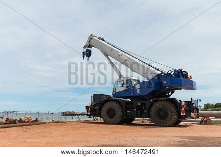 Mobile crane is waiting work at harbor