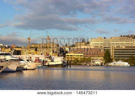 Sunrise over Lake Union in Seattle Washington USA. Lake Union panorama with boats and seaplane docks.