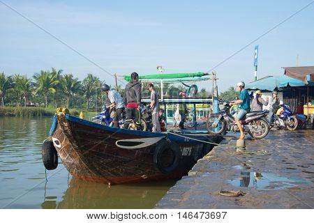 HOI AN, VIETNAM - JANUARY 04, 2016: Ferry from the town wharf on the river Thu Bon. Tourist landmark of the city Hoi An, South-East Asia