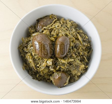 Chinese Traditional Food Chopped Pickled Green Cabbage with Chinese Olives in A Bowl.