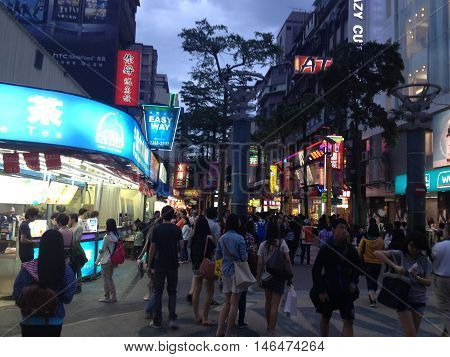 TAIPEI TAIWAN - MAY 5 : Locals and tourists walking at the Ximending street market in Taipei Taiwan on MaY 5 2013. This street is full of food stalls shops cafes restaurants.