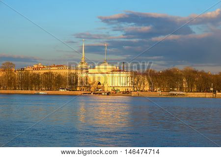 SAINT PETERSBURG, RUSSIA - APRIL 23, 2016: View of Admiralty embankment and the right wing of the Admiralty building in sunset April evening. Historical landmark of the city Saint Petersburg