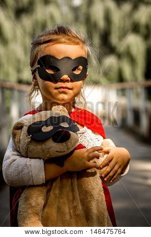 Beautiful Little Girl In The Image Of A Super Hero, Playing