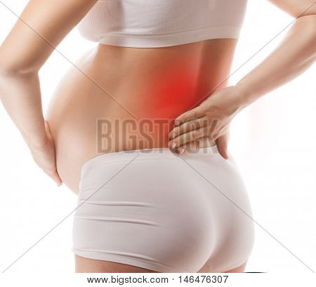 pregnant caucasian woman closeup body isolated on white background studio shot belly back pain