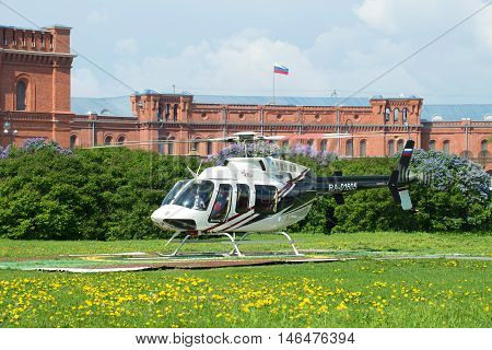 SAINT PETERSBURG, RUSSIA - MAY 22, 2016: Helicopter Bell 407GX (RA-01605) on the landing site at the front of the Museum of artillery. Tourist landmark