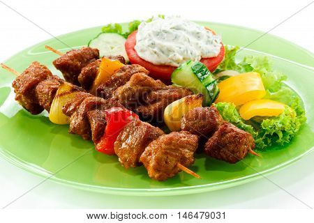 Grilled meat and vegetables kebab. Grilled kebab on a plate