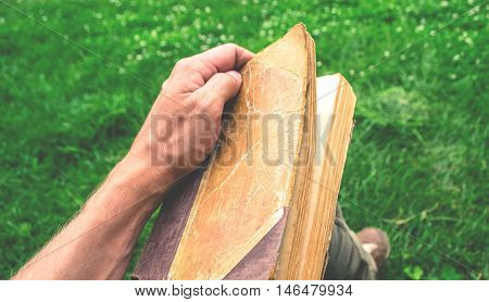 Old tattered book on grey wooden background