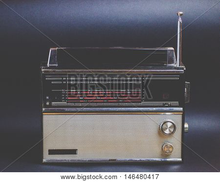 An old radio against a black background