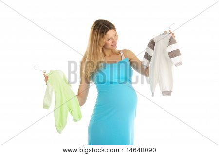 pregnant woman buying baby clothes