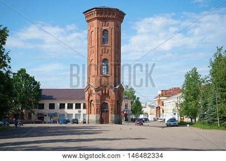 STARAYA RUSSA, RUSSIA - JUNE 02, 2016: View on the old water tower in the town square on a sunny june day. Historical landmark of the city Staraya Russa