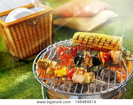 Aerial view of corn cob and vegetarian barbecue on a grilling pan. Grilled Kebab