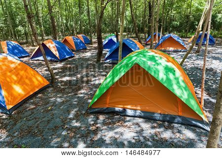 camping and tent tents set up in campsite outdoor sports concept