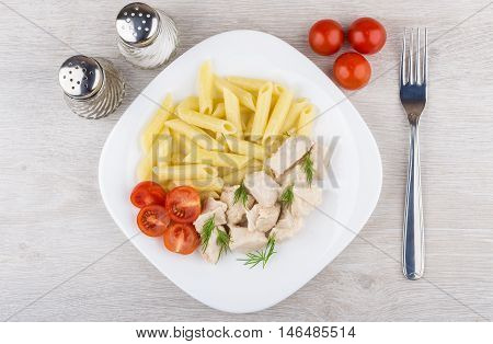 Plate With Pieces Chicken, Pasta And Tomatoes, Fork