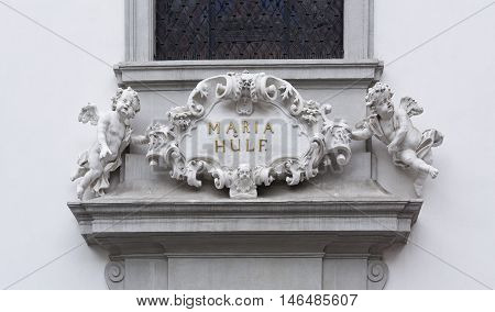 VIENNA, AUSTRIA - September 3, 2016: Detail of the church name Maria Hulf on a plate above the main entrance, on September 3, 2016 in Vienna, Austria