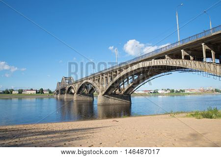 The road bridge in Rybinsk, sunny day in july. View from the left bank of the Volga river