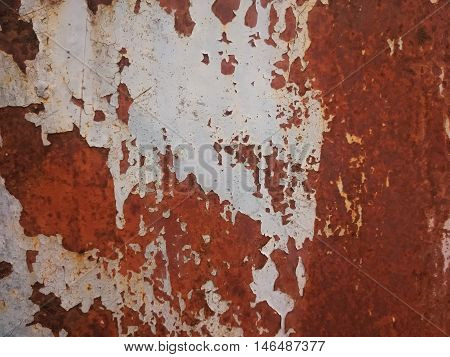 aged and decayed metal surface in brown and grey
