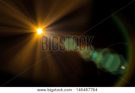 Abstract flare in black background. It looks bright shine and glittering. You can apply for flare wallpaper, flare background, flare backdrop, product display and artwork design.