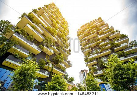 Milan, Italy - June 05, 2016: Pair of residential towers with trees called Bosco Verticale in the Porta Nuova district designed by Boeri Studio