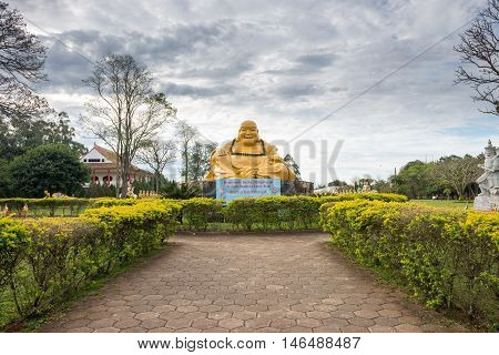 Giant Buddha Statue In The Gardens Of The Temple