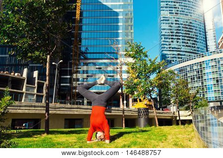 Young Girl Doing Yoga Outdoors In City